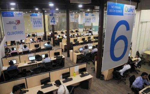 Employees of India's largest online classifieds company Quikr work at company headquarters in Mumbai on May 5, 2014