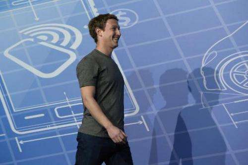 Facebook's 29-year-old billionaire creator Mark Zuckerberg arrives on the opening day of the Mobile World Congress in Barcelona,
