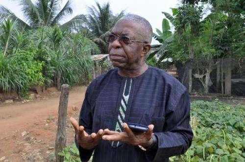 Father Godfrey Nzamujo, director of the Centre Songhai, speaks on the farm in Porto Novo, Benin, on January 30, 2014