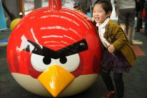 "File photo shows a young girl playing at Shanghai's first ""Angry Birds"" Activity Park at Tongji University in Shanghai"