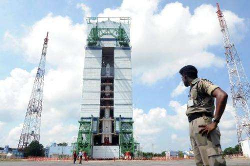 File photo taken on October 30, 2013 shows a security forces member keeping watch on the PSLV-C25 launch vehicle at the Indian S