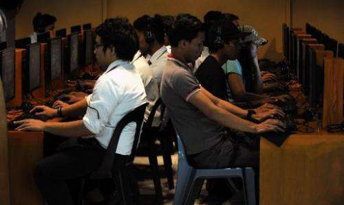 Filipino youths use the Internet at a cafe in Manila on February 18, 2014
