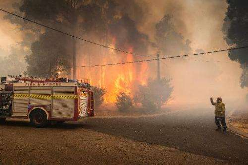Firefighters try to contain wildfires in the Stoneville area, a suburb east of Perth in the state of Western Australia on Januar