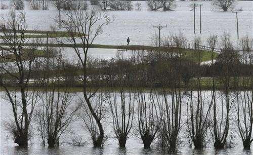 Flooded British villages ignite climate debate