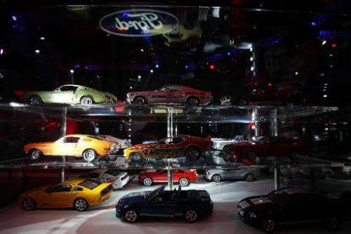 Ford cars on display at the 50 Years of Mustang celebration ceremony in Beijing on April 19, 2014