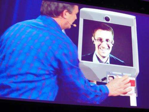 Former NSA contractor Edward Snowden appears by remote-controlled robot at a TED conference in Vancouver on March 18, 2014