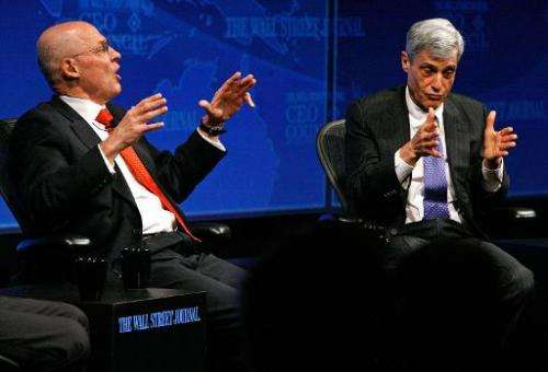 Former US Treasury Secretaries Henry Paulson (L) and Robert Rubin participate in a panel discussion on November 17, 2008 in Wash