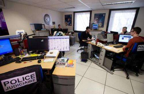 French police officers of the PHAROS internet investigation unit work in Nanterre, near Paris, on February 4, 2014. PHAROS is pa