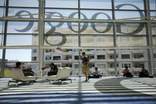 Google logo is seen through windows of Moscone Center in San Francisco on June 28, 2012