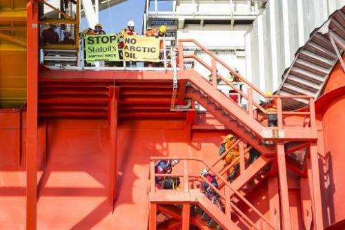 Greenpeace International activists from eight countries scale and occupy Statoil contracted oil rig Transocean Spitsbergen on Ma