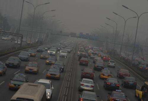 Heavy traffic is seen on the second ring road as air pollution continues to shroud Beijing, on February 26, 2014