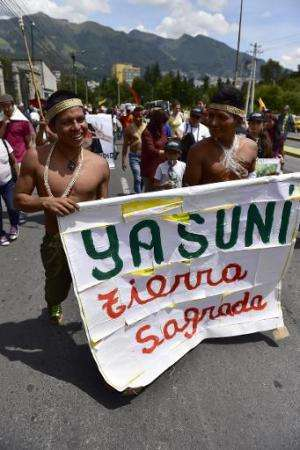 Huaorani natives and Yasunidos ecologist group activists march in Quito on April 12, 2014 towards the National Electoral Council