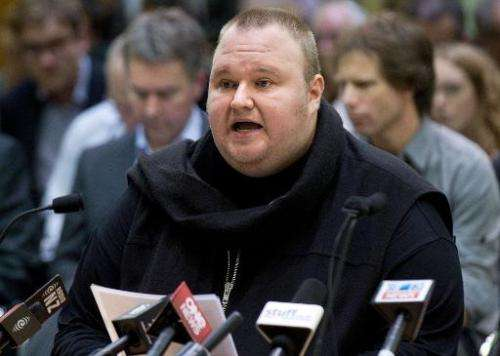 Internet mogul Kim Dotcom speaks at a meeting with New Zealand Prime Minister John Key at Bowen House in Wellington on July 3, 2