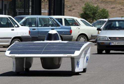 Iranian students from the Qazvin Azad Islamic University test drives the solar-powered Havin-2 vehicle in Qazvin on June 2, 2014