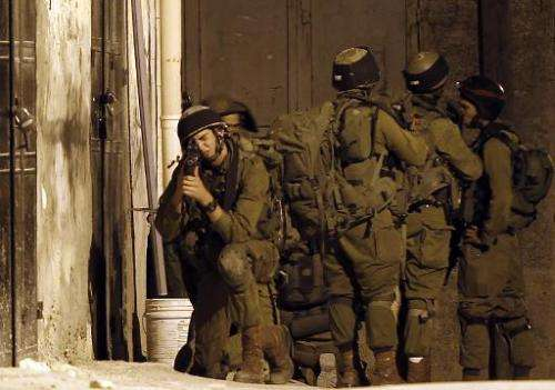 Israeli soldiers take part in a search operation in the West Bank village of Awarta on June 26, 2014,