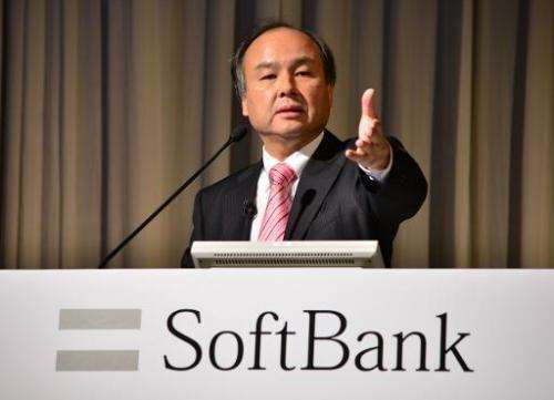 Japan's SoftBank Corp. founder and President Masayoshi Son holds a press briefing in Tokyo on February 12, 2014