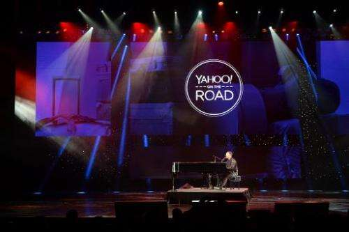 John Legend performs during the keynote address by Yahoo CEO Marissa Mayer at  the 2014 International CES in Las Vegas, Nevada,