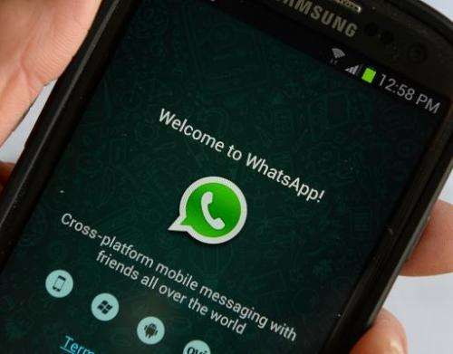 Logo of WhatsApp, the popular messaging service bought by Facebook for US$19 billion, seen on a smartphone February 20, 2014 in