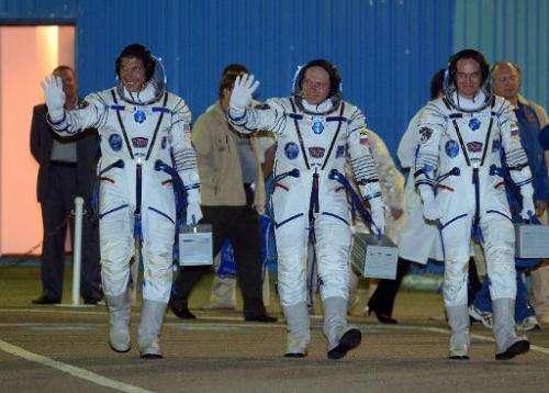 (L-R) US astronaut Michael Hopkins, Russian cosmonauts Oleg Kotov and Sergei Ryazansky at the Baikonur cosmodrome on September 2