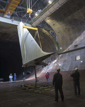 NASA aces delicate operation with aircraft tail