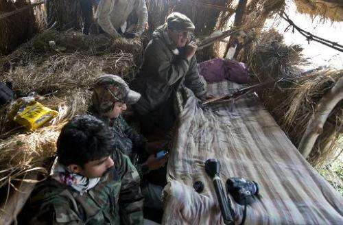 Nawab Shafat Ali Khan (top) and his team wait in the forest during a tiger hunt near the village of Barahpur in Bijnor District