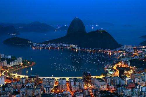 Night view of the Guanabara bay with the Sugar Leaf hill in the background (C) in Rio de Janeiro on October 30, 2012, Brazil