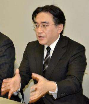 Nintendo President Satoru Iwata speaks during a press conference in Osaka, on January 17, 2014