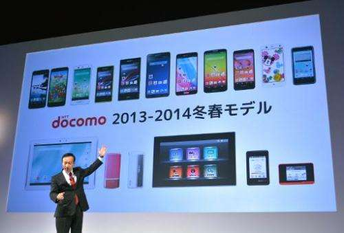 NTT Docomo's president Kaoru Kato speaks during a press briefing to announce the company's 2013/14 winter/spring models in Tokyo
