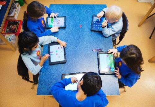 Nursery school pupils work with iPads on March 3, 2014 in Stockholm