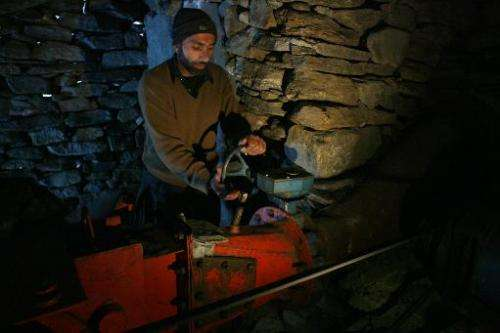 Pakistani Kashmiri technician Rahimullah operates a turbine at a small-scale hydro project in the mountainous Neelum Valley in P
