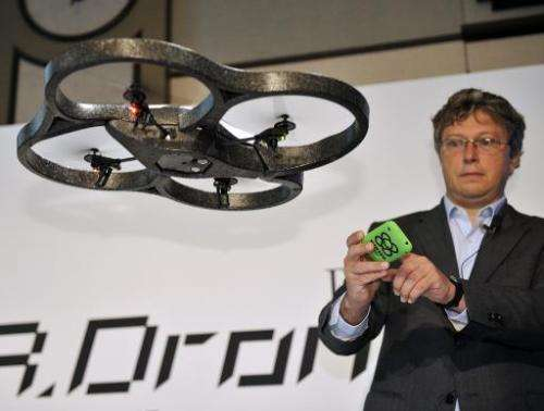 "Parrot CEO Henri Seydoux demonstrates the remote controlled toy helicopter ""AR.Drone"", operated by smartphone, in Toky"