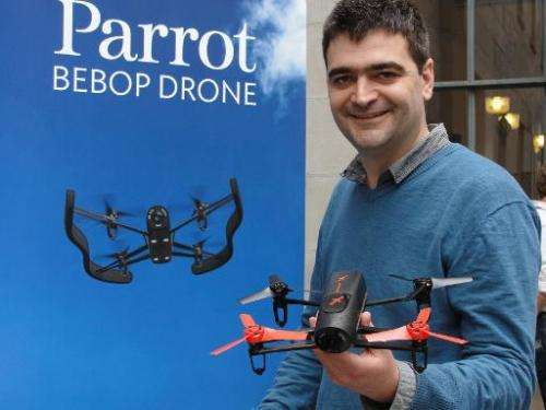 Parrot product manager Francois Callou shows off a Bebop Drone in San Francisco on May 8, 2014