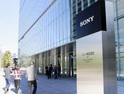 Pedestrians pass before the headquarters of Japanese electronics giant Sony in Tokyo on January 13, 2009