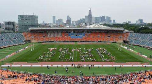 "People gather on the field of the National Stadium in Tokyo on May 25, 2014 to spell out ""Tokyo 2020"""
