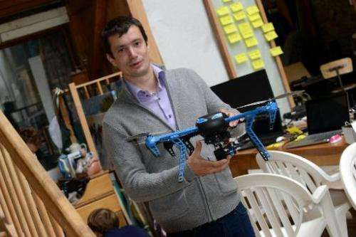 Project engineer Antoine Level shows a drone prototype named Hexo