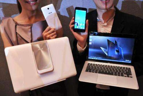 "Promoters display the new ""ASUS Transformer Book V"" by Taiwanese electronics company ASUS during a press conference ah"