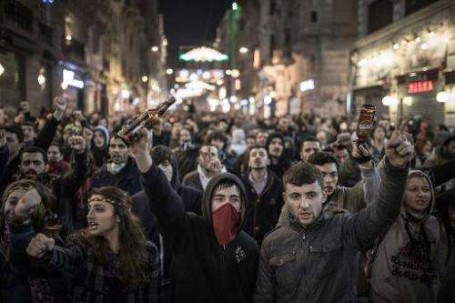 Protesters chant slogans against newly proposed restrictions on the use of the Internet and against the Turkish government durin
