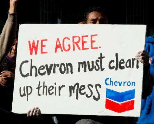 Protesters gather in the Federal Plaza in Manhatan to protest against Chevron Corporation on October 15, 2013 in New York