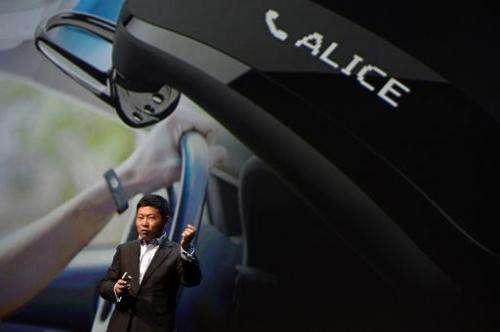 Richard Yu, CEO of Huawei's Consumer Business Group, presents the Talkband B1 at the Mobile World Congress in Barcelona on Febru
