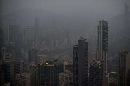 Smog haze hangs over the downtown business districts of Hong Kong on December 10, 2013