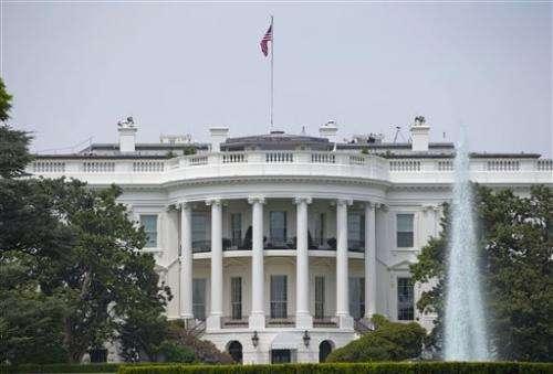 Sun rises on solar panels on White House roof