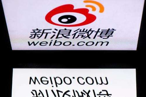 The chinese app Weibo's logo is displayed on a tablet on January 2, 2014 in Paris