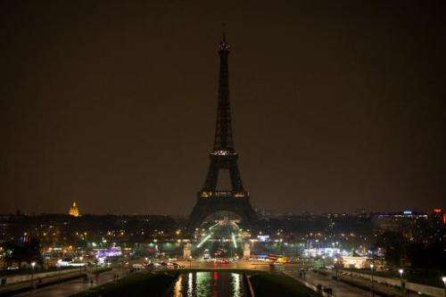The Eiffel tower is plunged into darkness during Earth Hour on March 23, 2013 in Paris