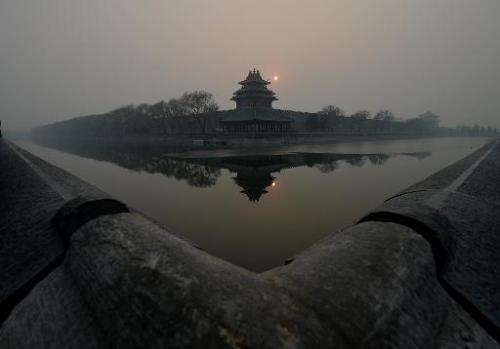 The Forbidden City is shrouded in heavy air pollution in Beijing on December 7, 2013