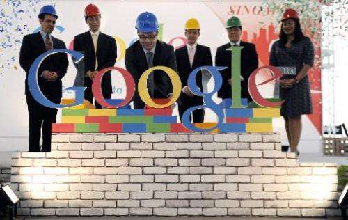 The Google letters are completed on stage at a press conference in Singapore on December 15, 2011