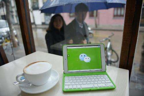 The logo of Chinese popular instant messaging platform called WeChat on a mobile device on March 12, 2014