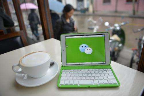 The logo of the Chinese instant messaging platform WeChat is shown on a tablet, March 12, 2014