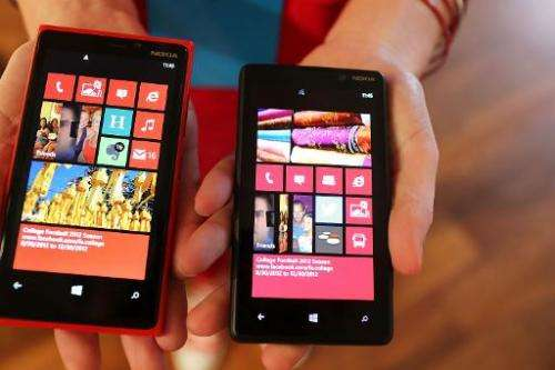 The Nokia Lumia 920 (L) and 820 Windows smartphones are displayed during a joint event with Microsoft on September 5, 2012 in Ne