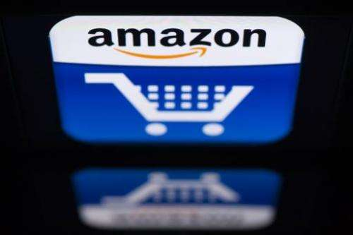 "The ""Amazon"" logo is seen on an iPad in Paris on November 13, 2012"