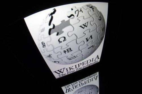 "The ""Wikipedia"" logo is seen on a tablet screen on December 4, 2012 in Paris"